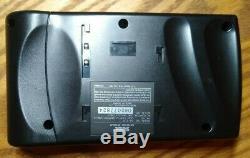 Sega Nomad handheld console with original plastic still on screen, Working